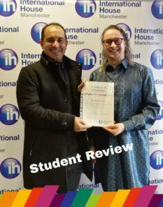 Student Alex receiving his certificate